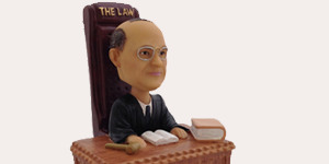 Introducing the Justice Stanley Reed Bobblehead